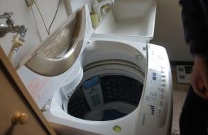 洗濯機修理。